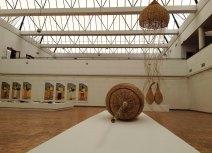 Foreground: Tapfuma Gutsa, Cocoon (2014), weaving.