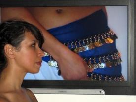 Zoulikha Bouadbellah in front of video Dansons (2003). Photo: Christine Eyene