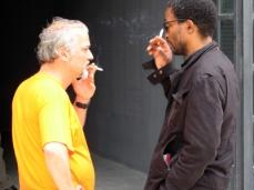Fernando Alvim and Simon Njami chatting at the entrance of the African Pavilion. Photo: Christine Eyene