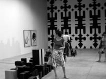 Foreground: visitor in front of Mounir Fatmi's installation Save Manhattan 03 (2006-07) background: Kendell Geers, Post Pop Funk 21 (2006), Sindika Dokolo Collection. Photo: Christine Eyene