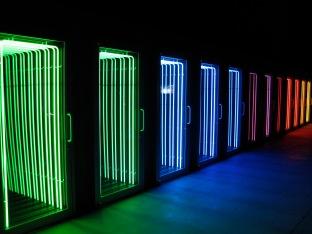 Iván Navarro, Death Row, 2006. Neon light, aluminum doors, mirror, one-way mirror, and electricity. © Iván Navarro.