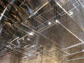 Nadia Kaabi-Linke, Flying Carpets, 2011. Chrome plated aluminium, stainless steel and threads.