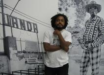 Angolan artist Kiluanji Kia Henda in front of the triptych Ngola Bar (2006). Photo: Christine Eyene