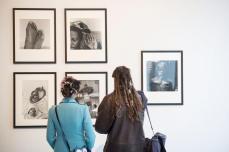 Visitors in front of George Hallett's work. Murder Machine opening. Photo: Shane Serrano.